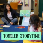 Librarian and Child at Story Time